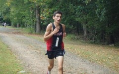 Newcomer leads team, breaks school running record