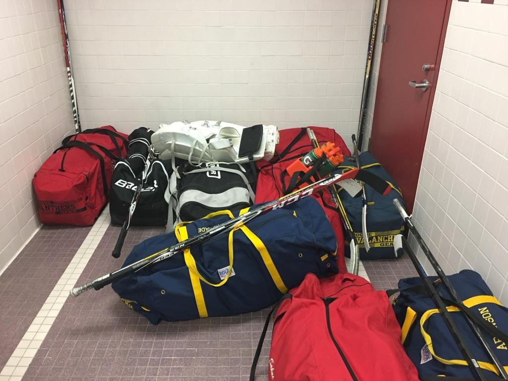 After being dragged through the school, hockey bags are stored in the locker room. An increase of enforcement of a safety policy prohibiting the use of the Sports' Lobby door has angered many students, specifically hockey players.
