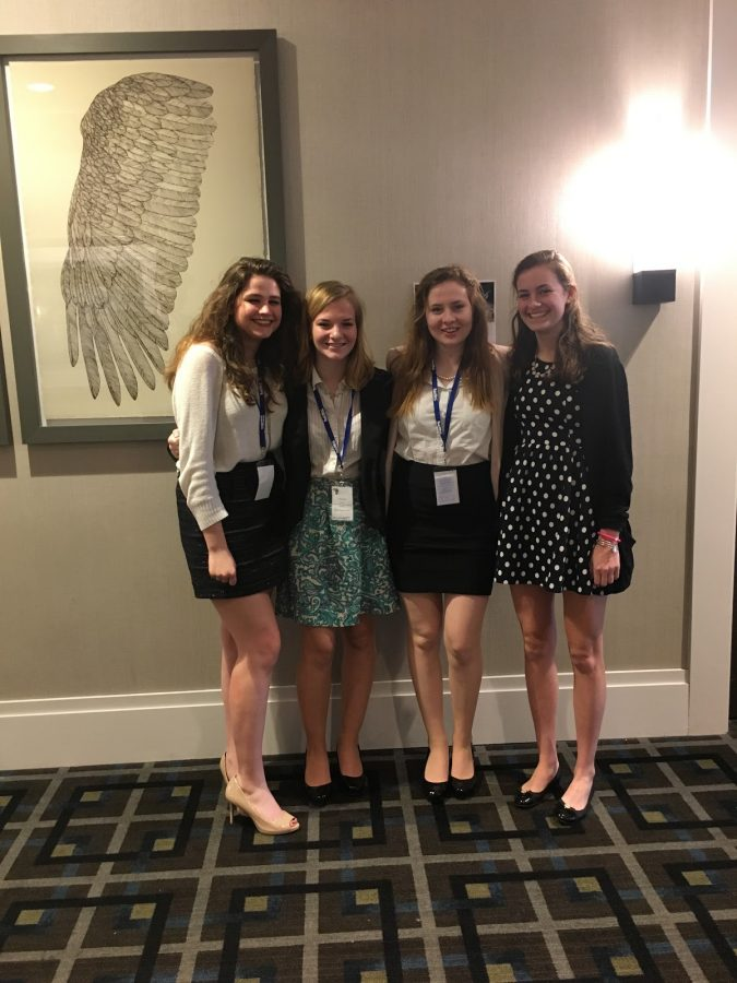 Seniors+Lindsay+Vachon%2C+Nina+Dunn%2C+Erin+Dunn%2C+and+Emily+Schaefer+pose+for+a+picture+after+a+committee+session+at+their+last+Model+UN+Conference+in+High+School.+%E2%80%9CI%E2%80%99ve+been+in+this+club+since+freshman+year%2C+I+joined+for+fun%2C+but+I%E2%80%99m+sad+it%E2%80%99s+my+last+trip+with+Model+UN%2C%E2%80%9D+Schaefer+said.+%0A