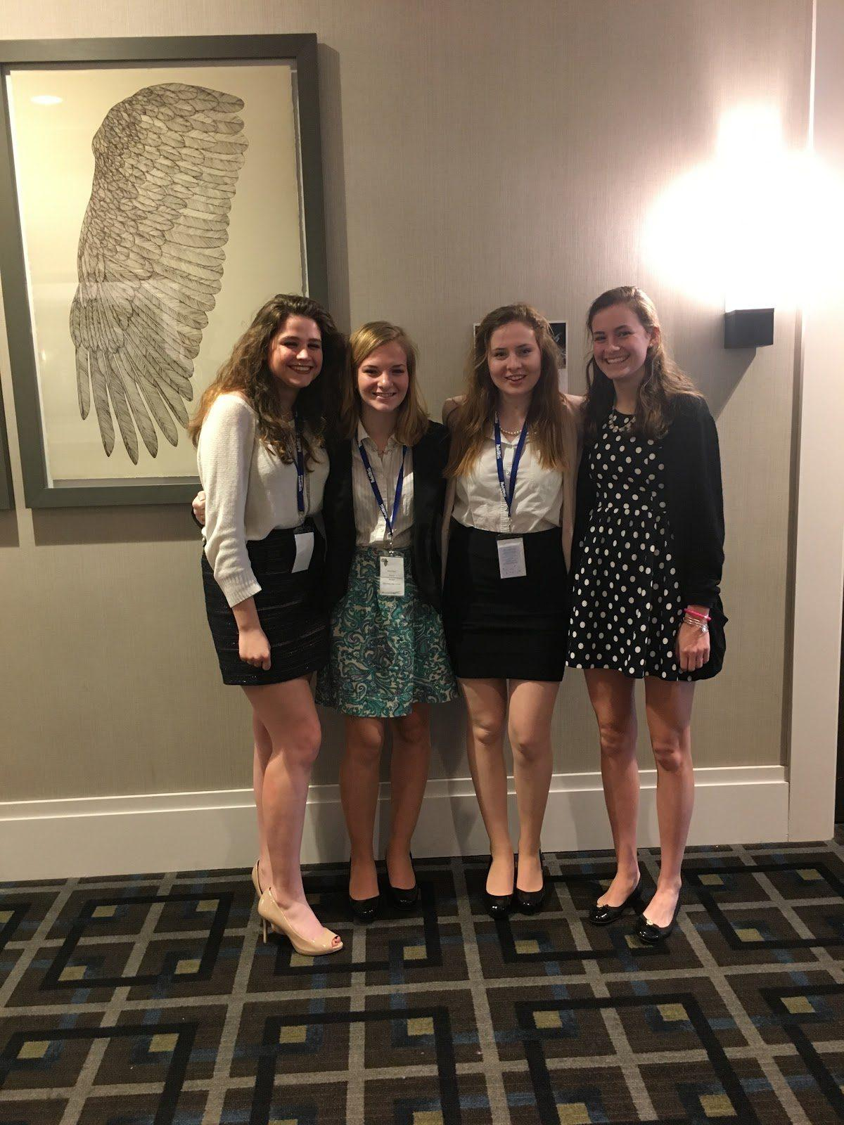 "Seniors Lindsay Vachon, Nina Dunn, Erin Dunn, and Emily Schaefer pose for a picture after a committee session at their last Model UN Conference in High School. ""I've been in this club since freshman year, I joined for fun, but I'm sad it's my last trip with Model UN,"" Schaefer said."