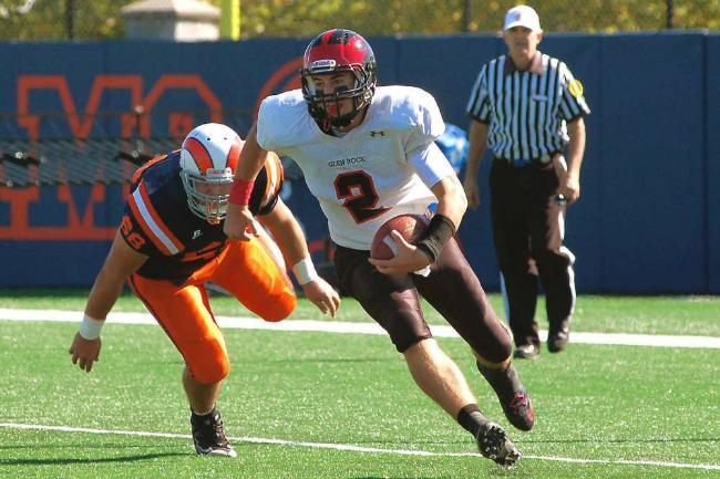 Senior Quaterback Mike O'Neill makes a football move to beat a Lodi defenseman.
