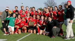 Girls' varsity soccer, playing with heart