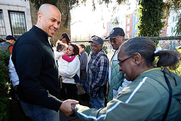 Meeting with Newark residents before his food stamp pledge, Mayor Cory Booker brings a lot to the table -- but does he bring it too soon?