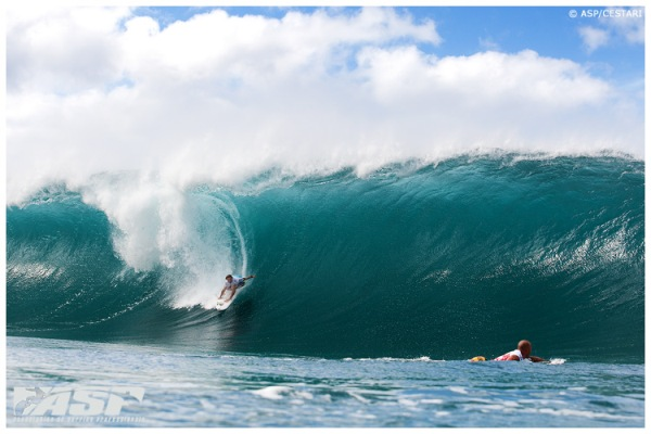 Riding gnarly waves, surfer Joel Parkinson won this year's Pipe Masters.