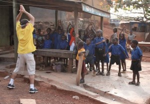 Sometimes it's best to not have a camera around your neck or on your shoulder. Here, Ken leads a bunch of pre-schoolers in Ghana, Africa, in jumping jacks during a break from shooting.
