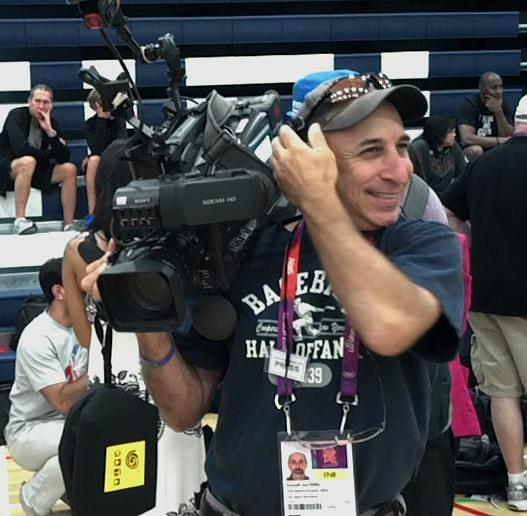 At the Olympics in London, 2012, covering a photo session with the USA Mens basketball Dream Team prior to their Gold-medal winning game.