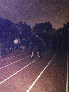 Students circle the track during their fundraising relay.