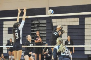 Demonstrating their skills, the GRHS Volleyball team is determined to keep winning.