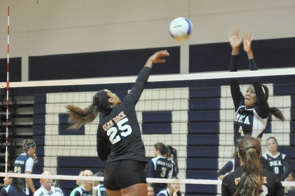 With great form, GRHS hitters dominate the net.