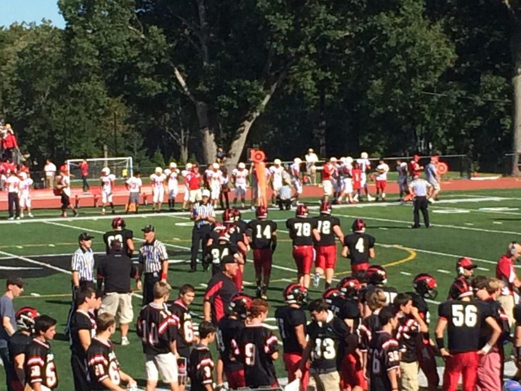 Jeff Kopyta (#14) leads the Panther offense onto the field.