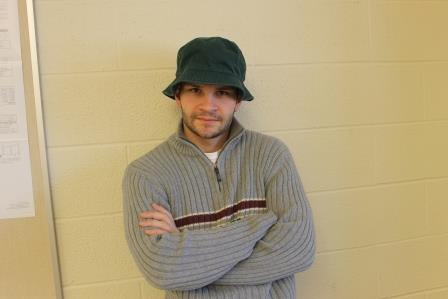 Mr. Corby brandishes the fabled, omniscient green bucket hat atop his dome.
