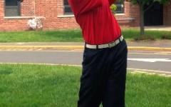 Andrew Nappi practices his swing.
