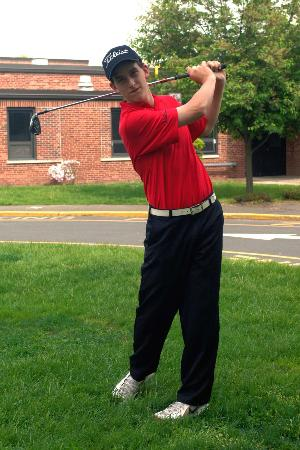 Andrew Nappi practices his swing.