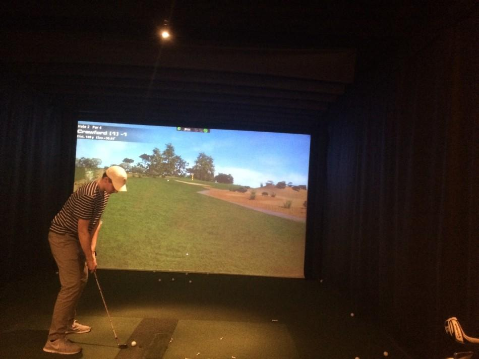 Forced into practice simulators such as this while they wait for the golf fields to open after an especially harsh winter, the Glen Rock High School golf team has tried to stay sharp.