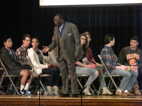 Gathered on stage to simulate a bus, students experienced first hand discrimination during the Civil Rights era.