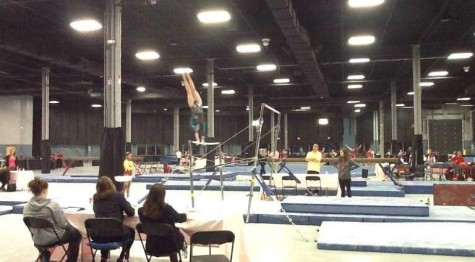 Poised here on top of the parallel bars, Struble is a high-level gymnast at sixteen years old.