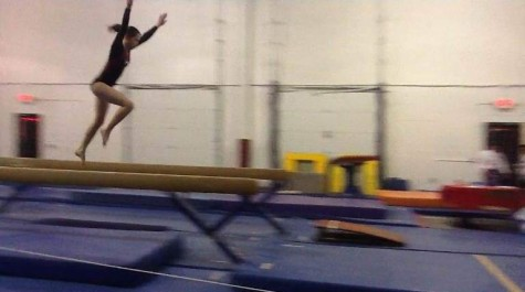 Her most nerve-wracking event -- the beam -- does not stop Struble from being graceful, as she launches here toward dismount.