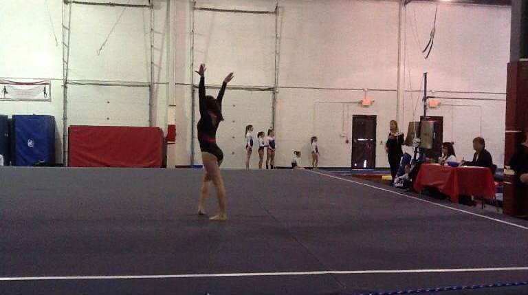 Performing+her+floor+routine%2C+Sydney+Struble+competes+in+a+competition+prior+to+her+injury.++