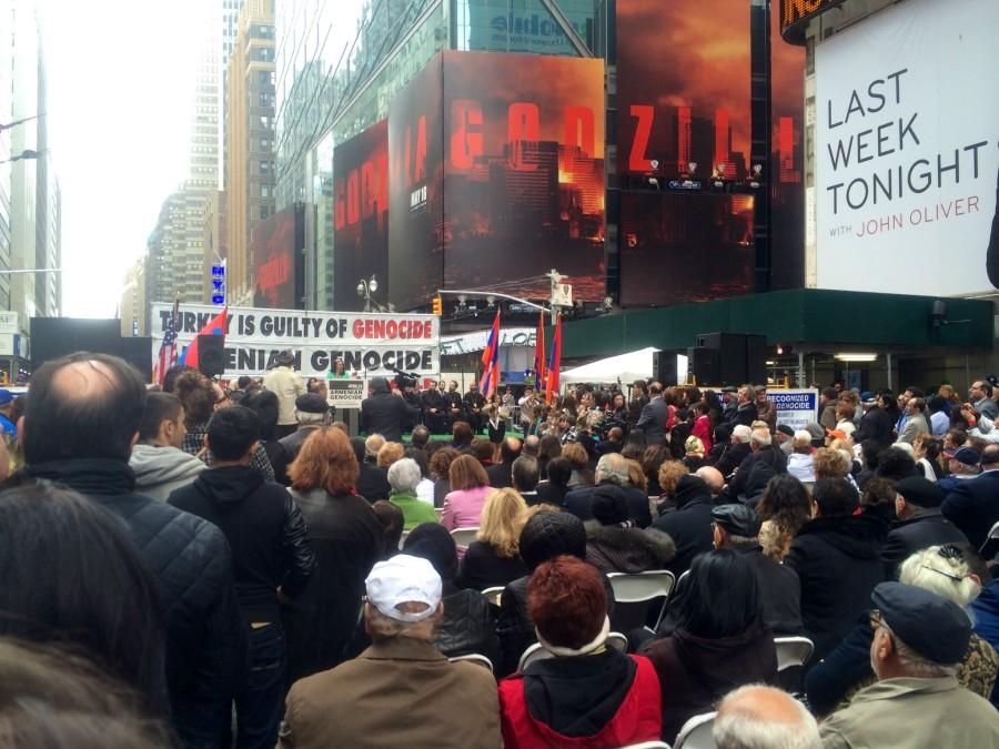 The voices of different speakers boom throughout Times Square, disseminating information to non-Armenians.