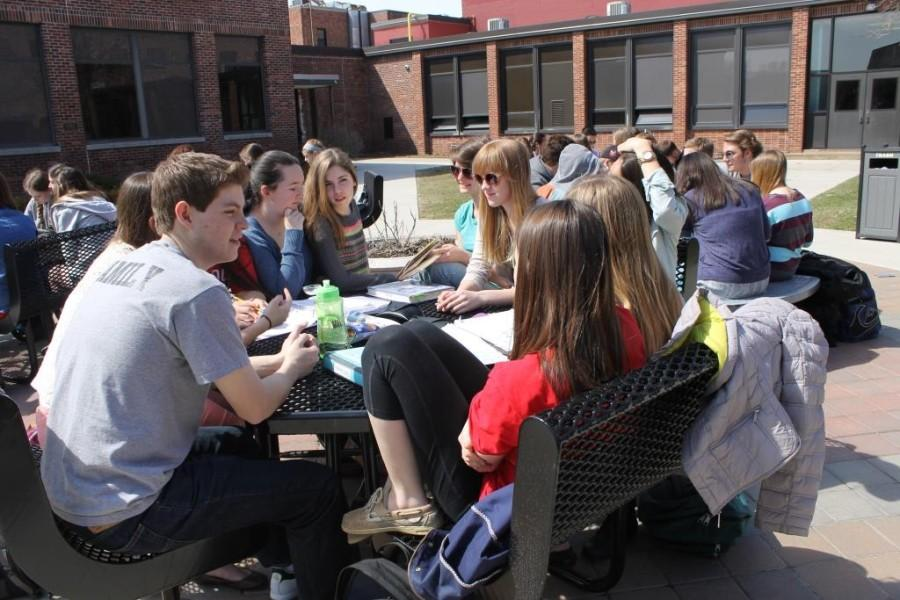 While students enjoy a nice day in the courtyard, questions arise as to where students will eat next year during the communal lunch on a rainy day.