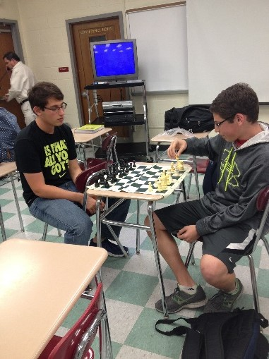 President Jonathan Kane ('15) starts to play a chess game against his teammate and brother Adam Kane ('16).