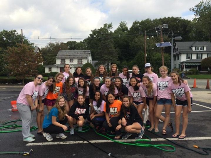 The volleyball team recently held a free car wash. They received over $1000 in donations, showing that they work well together on and off the court.