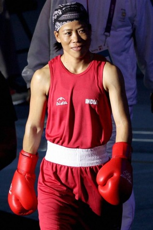 Image from : http://indiatoday.intoday.in/gallery/olympics-mary-kom-settles-for-bronze/1/7542.html