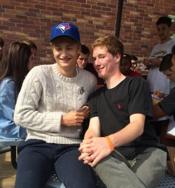 Mathias Weckstrom (left) enjoys lunch because it's time he gets to spend with his friends.