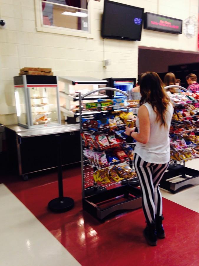 A freshman, Julia Blando, purchases chips.