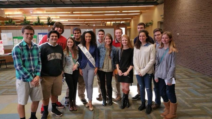 Miss New Jersey, senior at Rutgers, stands beside Glen Rock journalism students.