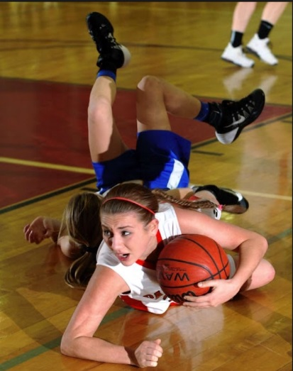 Senior Lee Maitner dives on the floor in the attempt to keep the possession of the ball. This will be her fourth year on varsity.