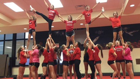 Despite the football season ending officially in mid-November, the cheerleaders remain out in full force as they practice for competitions in late November and early December.