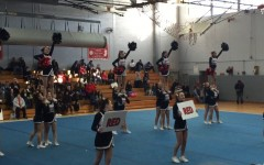 Cheerleaders compete at a fall competition.