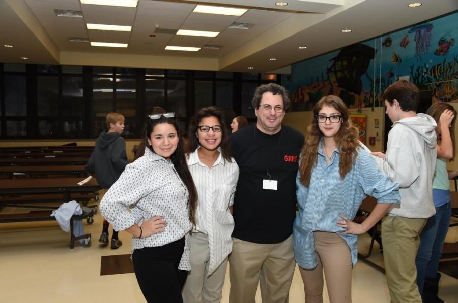 Mr. Feldman with seniors Aggy Blevin, Michelle Greeley, and Ariana Felipe.