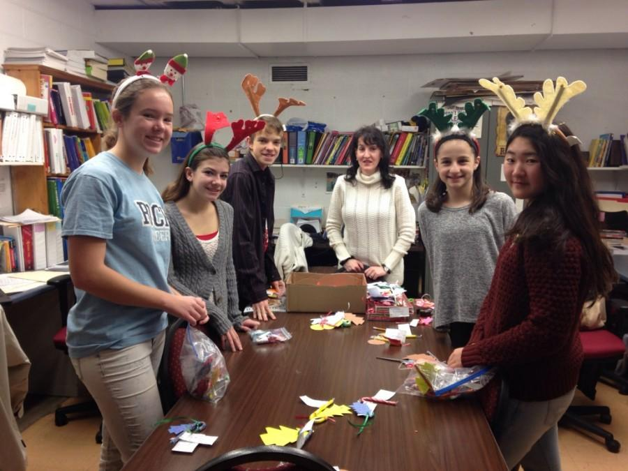 A few class officers preparing completed candy grams for delivery. (From left to right) Jean Walter, Janine Downing, Nicholas McRae, Jacqueline Stoller, Selma Sose, and Rena Mototani.