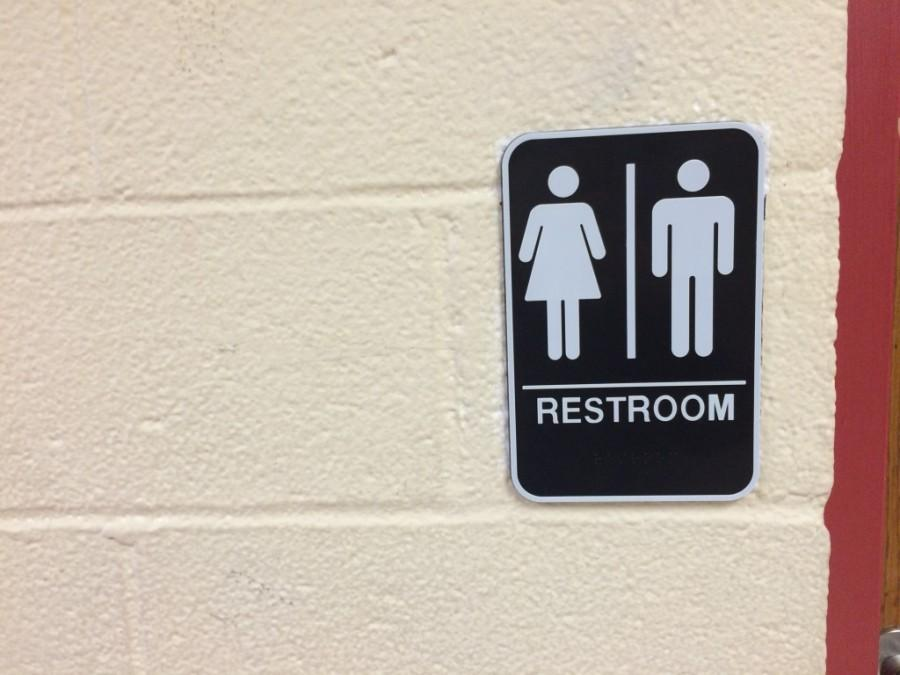 A sign indicating the unisex bathroom located in the junior hallway was installed shortly after winter break, a step toward making the school more accessible.