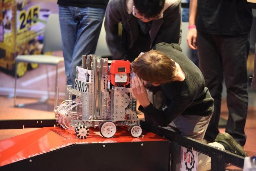 Founding member of the robotics team, Nick McRae, does the finishing touches on the robot before it competes.