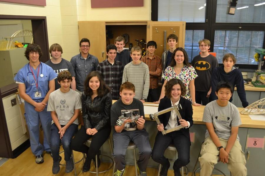 The robotics team, along with their advisers Luckenbill and Resnick, pose for their team picture for the yearbook.