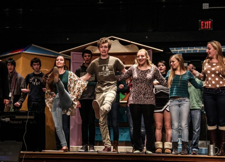 Blythe Owen (Belle),  Jack Whyte (Lumiere), Maddie Basirico (Babette), Annie Burke (Wardrobe), and Abby Koenig lead the ensemble in a dance number.