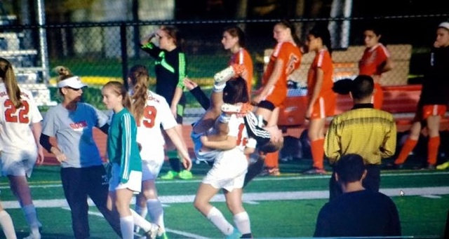 Jaclyn Mills, sophomore, tore her ACL this past fall and was carried off the field by her teammate, Julia Kelly, junior.