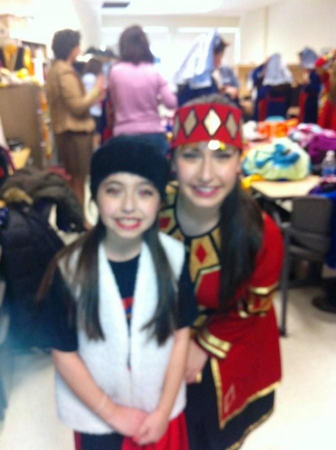 Victoria and Alyssa Messikian getting ready for a traditional Armenian dance performance.