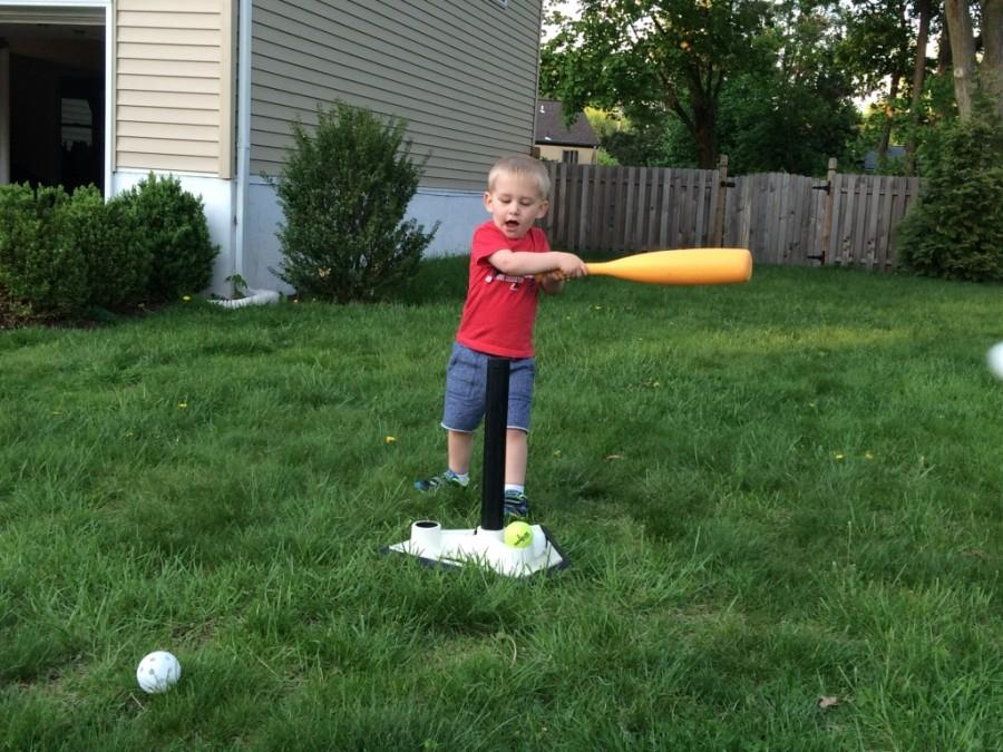 Charlie Hessenthaler is out on a nice day playing T-Ball. Charlie will be going into kindergarten in two years.