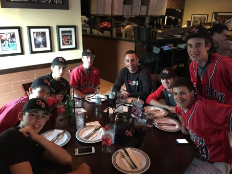 Freshman baseball coach, Dan Polles, sitting with members of the team at Anthony's Coal Fired Pizza.