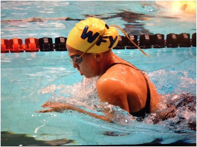 Bridget swimming breaststroke.
