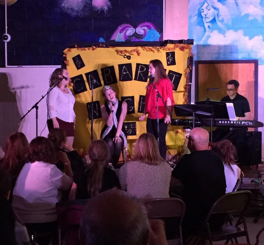 Bennie Fontana ('16), Melanie Lota ('16) and Rachel Beeksma, a new choir director this year, sing Popular from Wicked.