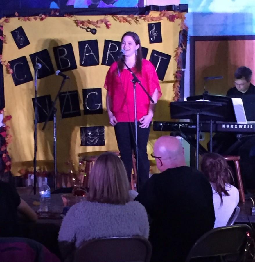 Melanie Lota ('16) sings Hallelujah by Leonard Cohen as Mr. Helder accompanies her.
