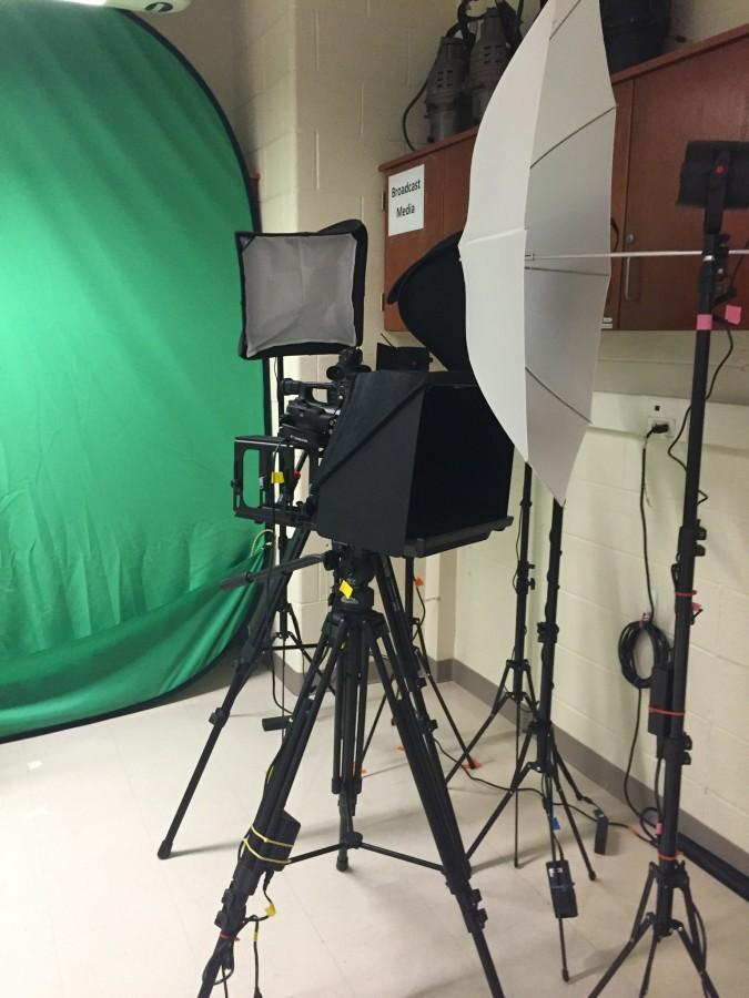 The new broadcast cameras and green screen in the Broadcast Media classroom.