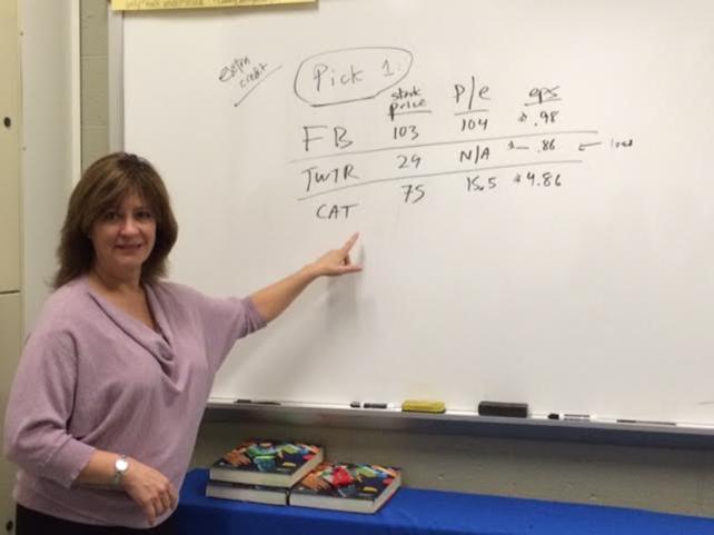 New teacher Ms. Uma Kearns teaches her financial literacy class.
