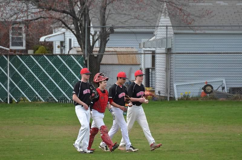 Palmeri discusses pitching with senior pitchers Greg Warner, Connor Browne, and junior catcher John Scandale.