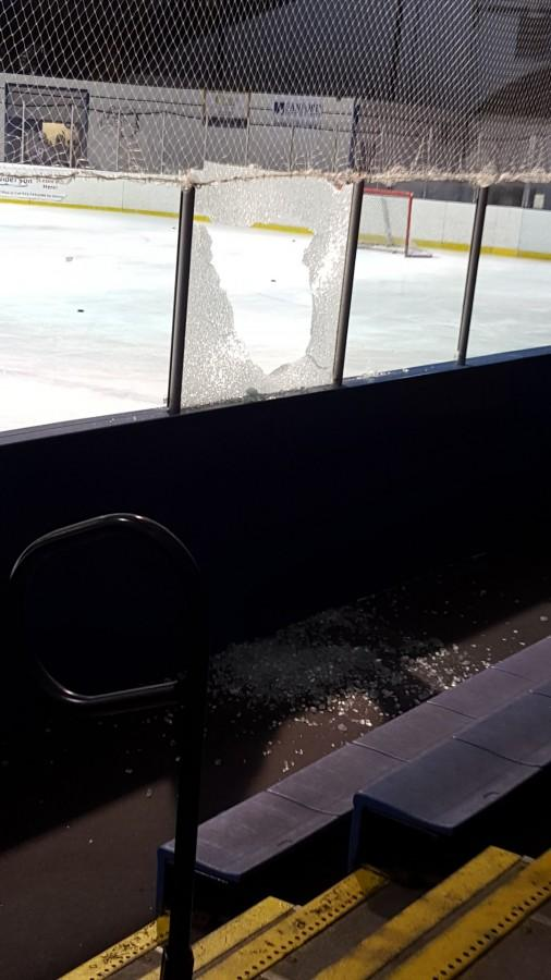 Broken glass covers the floor and ice of Clay Anderson arena in Montclair. The teams were slated to play at 7:45 p.m. on Wednesday, Dec. 2.  The fans and players grew restless as they waited over an hour for the game to start but were ultimately disappointed to learn that the game was cancelled.